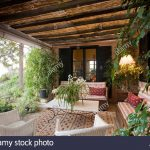 comfy sofas and white lloyd loom chairs oin outdoor living room on