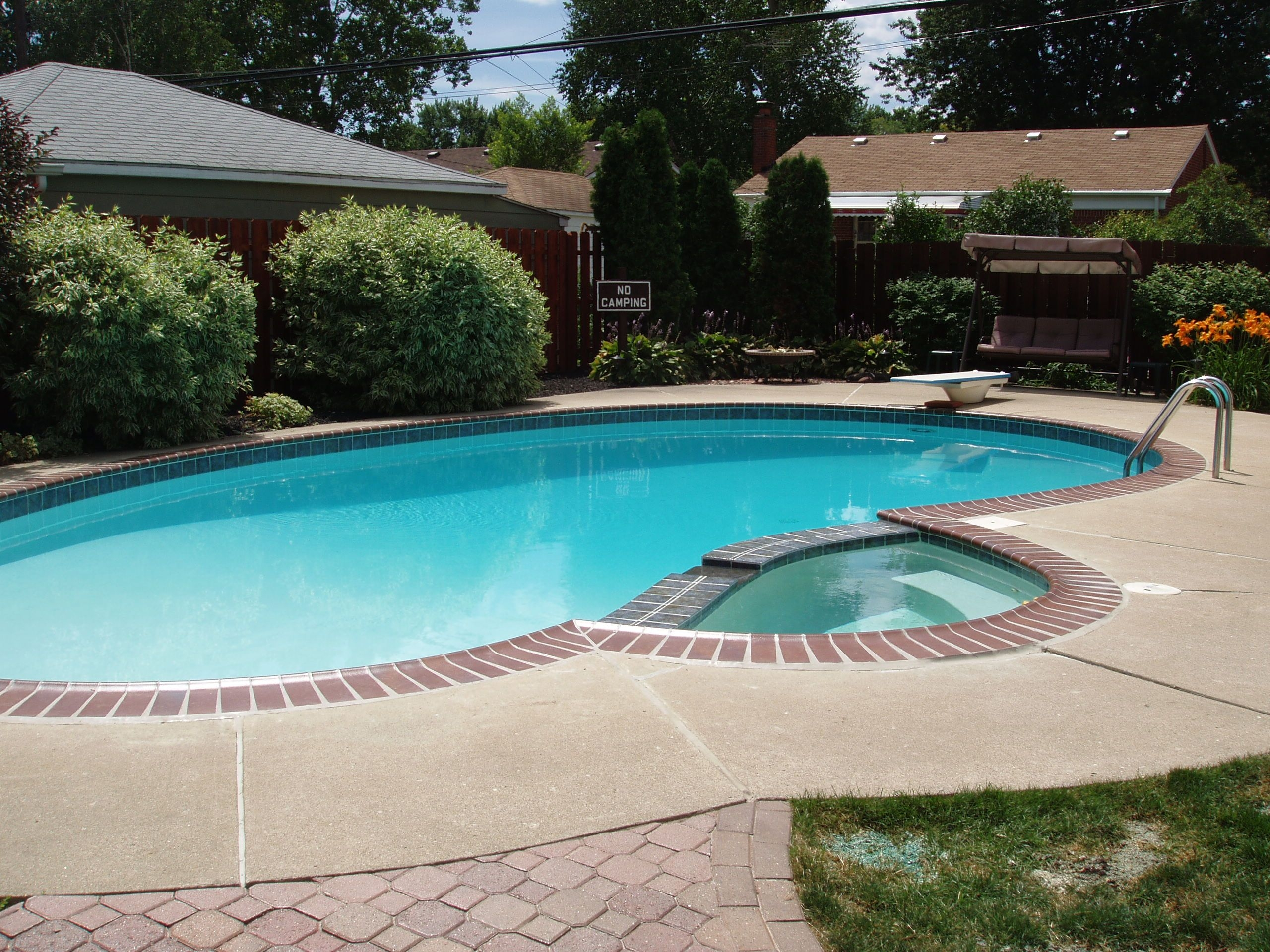 lining a pool edge with thin brick tile is an excellent decorative