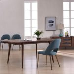 modern walnut dining table with antique brass feet