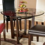 signature design ashley charrell round glass top table wayside