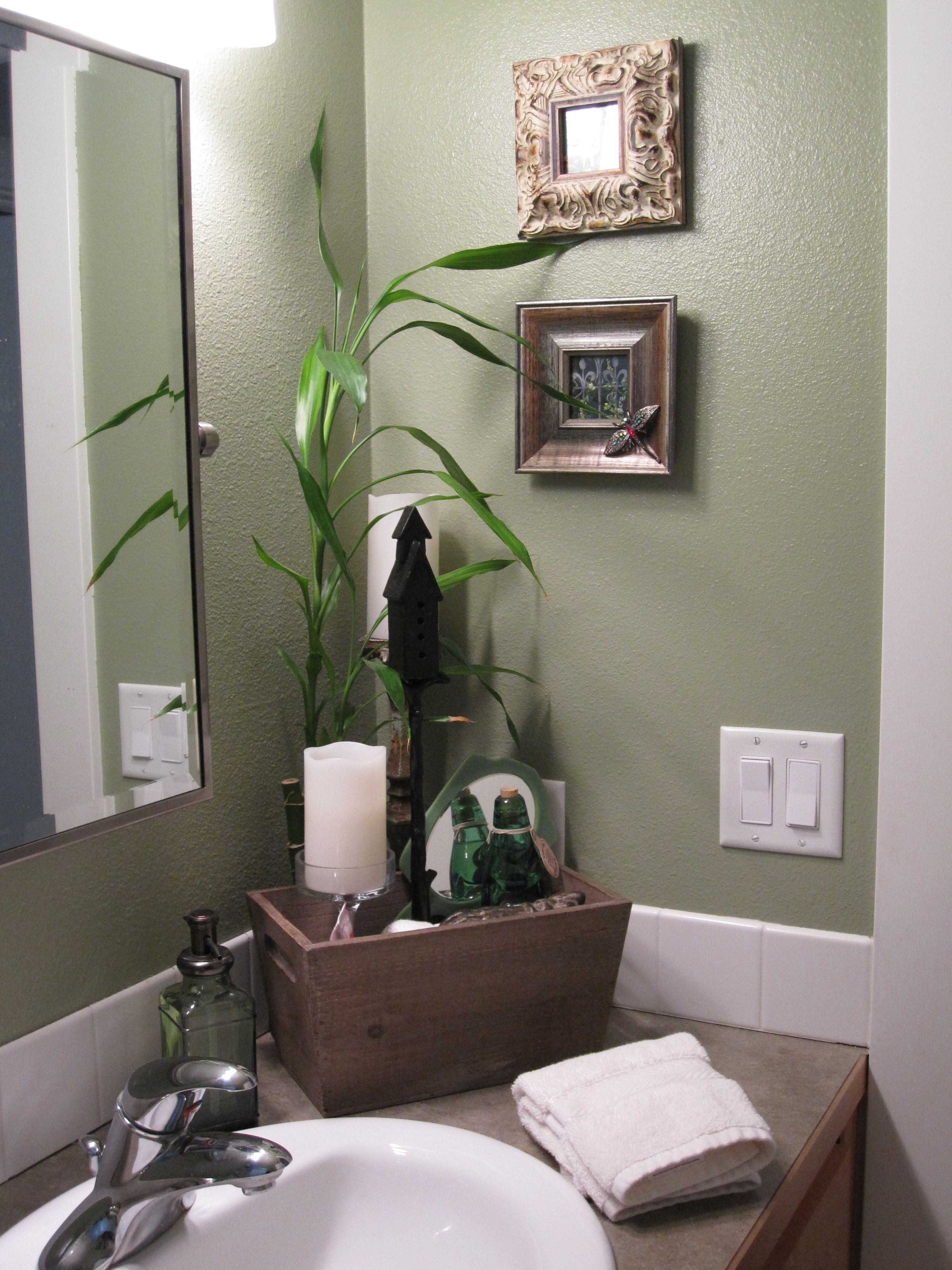 spa like feel in the guest bathroom the fresh green color makes the
